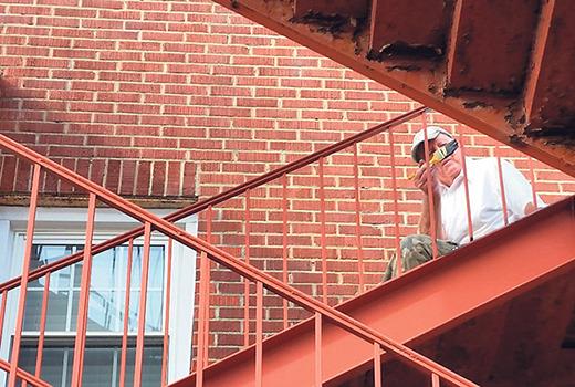 John Aspray paints fire escape