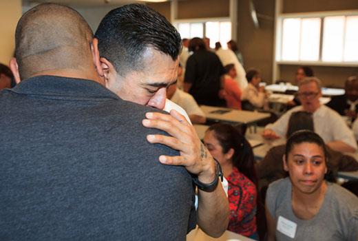 Michael Rios, a graduate of Southwestern Seminary's Texas prison extension seminary program, hugs a family member following the May 9 commencement. (SWBTS Photo/Matt Miller)